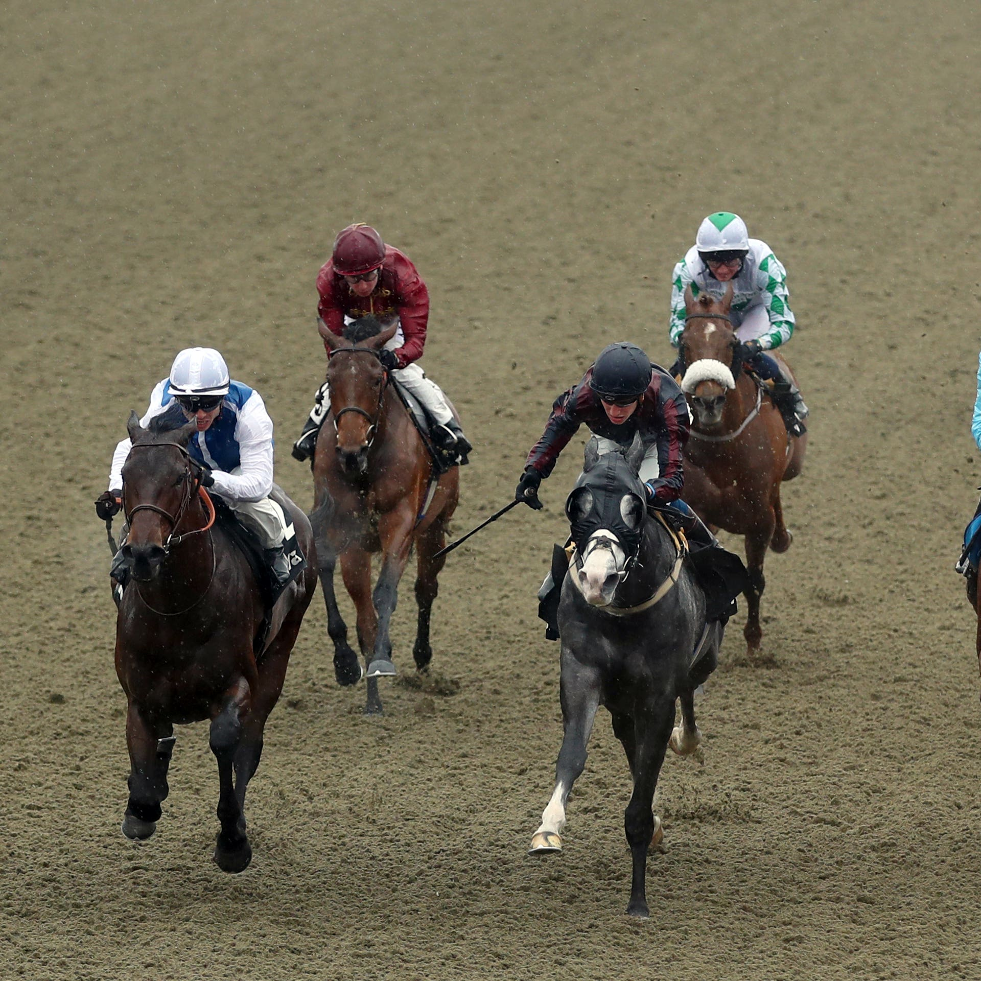 Funny Kid (left) winning the All-Weather Marathon Championships at Lingfield