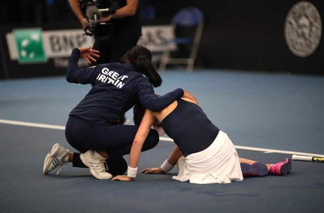 Johanna Konta collapsed after victory and was helped by Anne Keothavong during the Fed Cup clash with Serbia