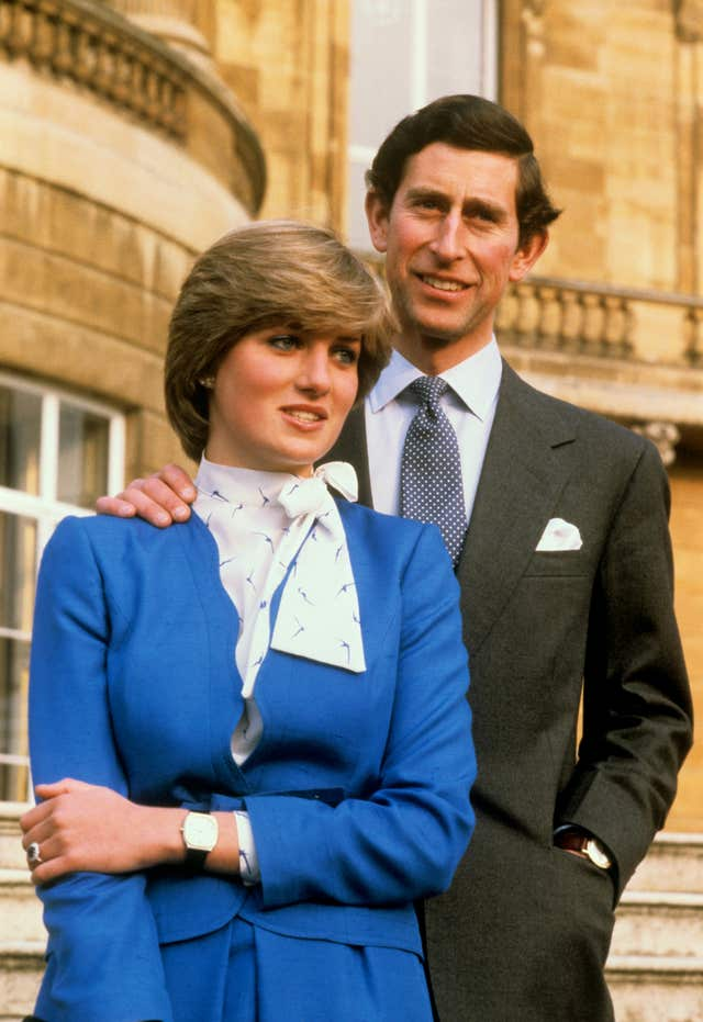 Prince of Wales and Lady Diana Spencer in the grounds of Buckingham Palace after announcing their engagement