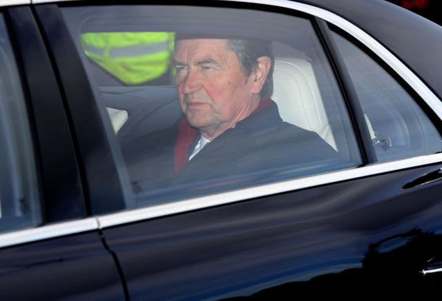 Vice Admiral Sir Tim Laurence also seen arriving at the palace for the Christmas lunch. Aaron Chown/PA Wire