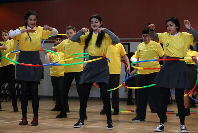 Hula hoop exercise at Holyrood Secondary School in Glasgow (Andrew Milligan/PA)