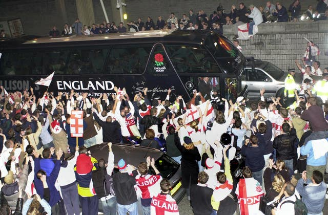 England's bus is mobbed by fans at Heathrow Airport