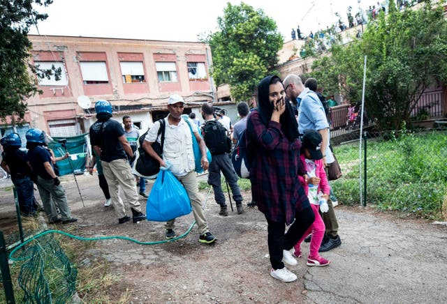 Police evict people from an abandoned school which they had occupied on the outskirts of Rome