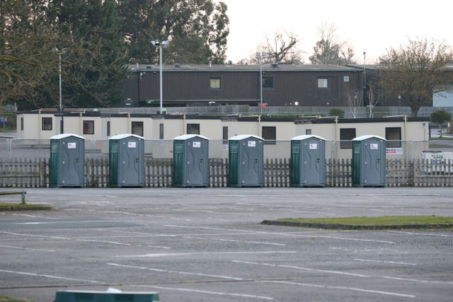 Temporary buildings are erected for coronavirus testing for NHS workers in the car park of Chessington World of Adventures in Chessington, Greater London