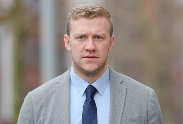Ireland and Ulster rugby player Stuart Olding arrives at Belfast Crown Court (Niall Carson/PA)