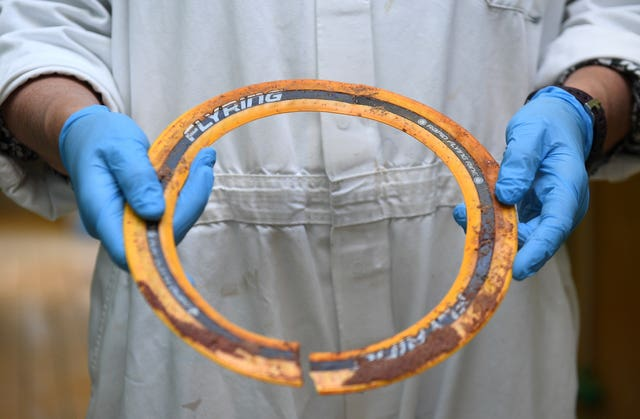 The plastic frisbee removed from the neck of Sir David