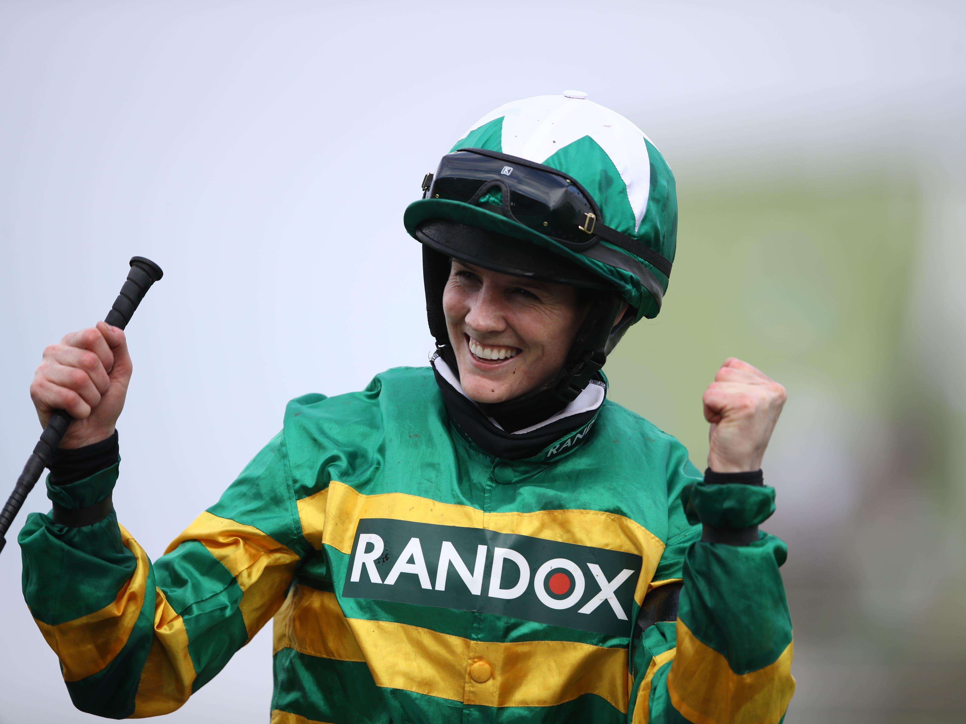 Rachael Blackmore celebrates winning the Randox Grand National on Minella Times (Tim Goode/PA)