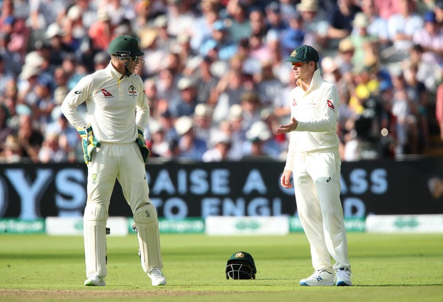 Steve Smith, right, offers his input to captain Tim Paine