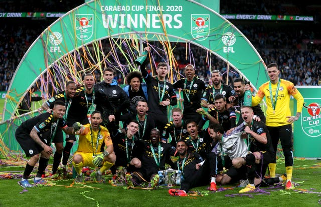 Manchester City players celebrate winning the Carabao Cup final