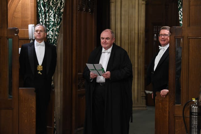 The European Union (Withdrawal Agreement) Bill being carried between the two Houses of Parliament by the Clerk of Legislation Liam Laurence Smyth