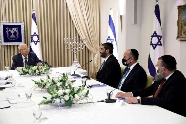 Israeli President Reuven Rivlin, left, speaks during consultations with party representatives on who might form the next coalition government (Amir Cohen/AP)