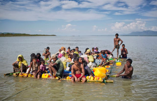 Rohingya Muslims on a raft made with plastic containers  (A.M. Ahad/AP)
