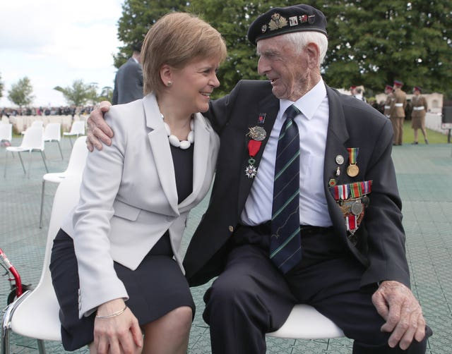 Scottish First Minister Nicola Sturgeon with D-Day veteran John Greig, 95, from Dumfries, at the Commonwealth War Graves Commission Cemetery in Bayeux