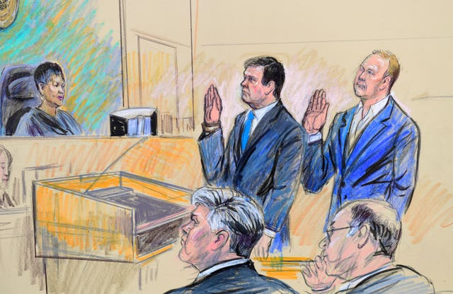 A court artist drawing shows Manafort and Gates in federal court