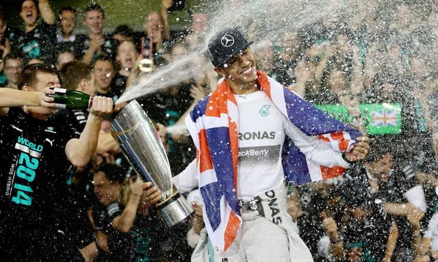 Hamilton celebrates becoming world champion again after victory in Abu Dhabi
