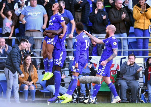 Cardiff's Bobby Reid, left, is held aloft after scoring in the 4-2 victory over Fulham