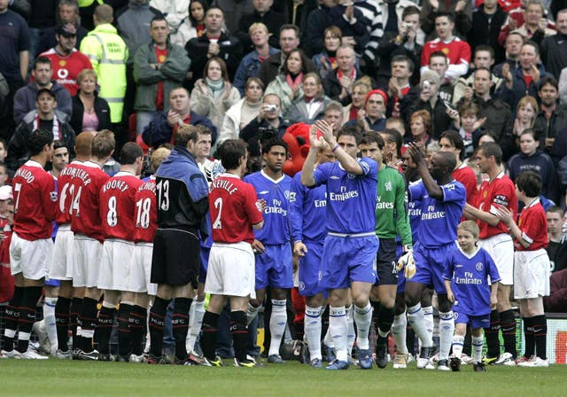 Chelsea players walk through a guard of honour in 2005