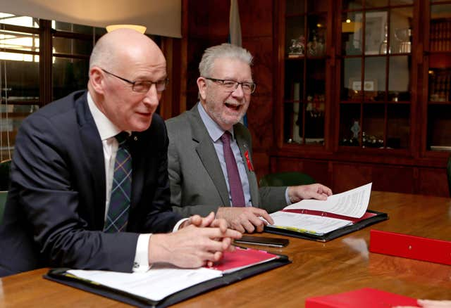 Scotland's Deputy First Minister John Swinney and Brexit Minister Mike Russell (Jane Barlow/PA)