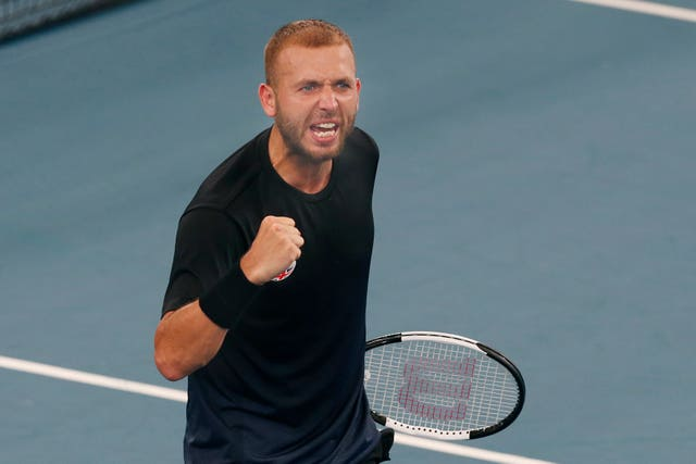 Dan Evans celebrates his victory over Alex De Minaur at the ATP Cup