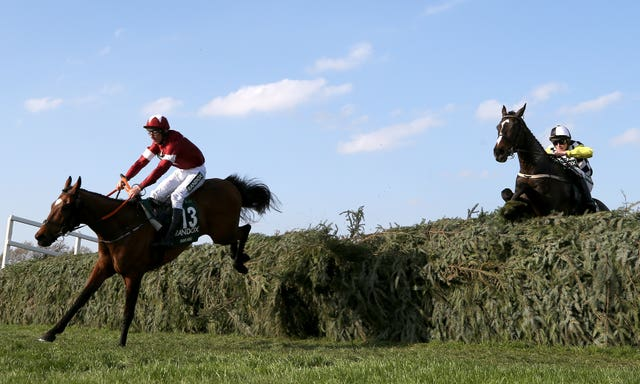 Tiger Roll leads Pleasant Company on the way to Grand National glory