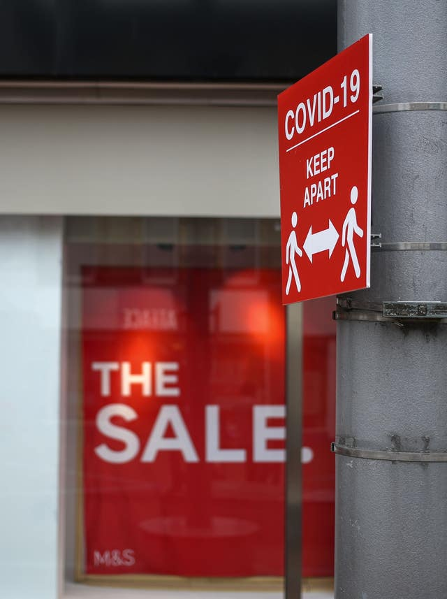 A social distancing information sign in front of a Marks and Spencer shop window advertising a sale in Reading, Berkshire, some six months on from the evening of March 23, when Prime Minister Boris Johnson announced nationwide restrictions