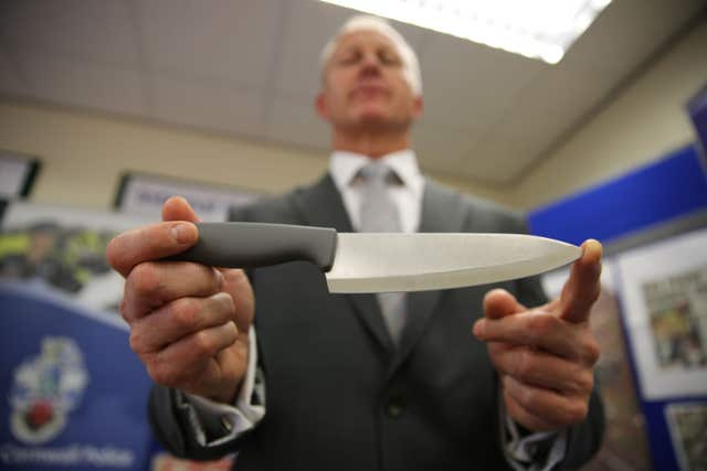 Retired Detective Superintendent Paul Burgan holds a kitchen knife which is believed to be similar to the weapon used to murder Kate Bushell in 1997 (Devon and Cornwall Police/PA).