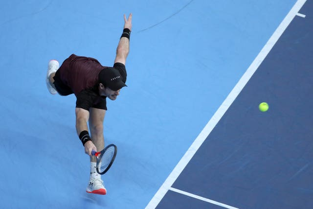 Andy Murray lunges for a forehand