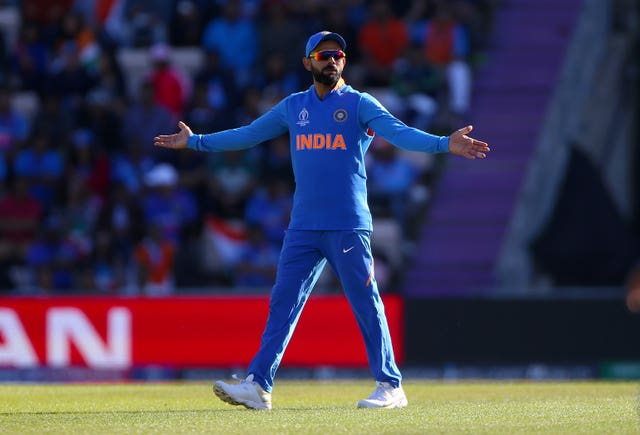 India's Virat Kohli guided his men through
