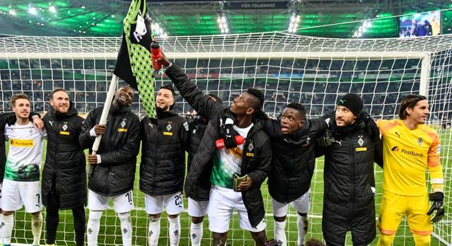 Breel Embolo celebrates with his Borussia Monchengladbach team-mates