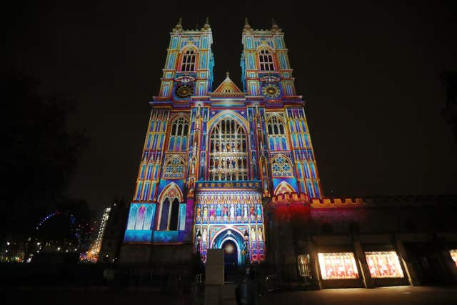 The Light Of The Spirit by Patrice Warrener is projected onto Westminster Abbey (Jonathan Brady/PA)