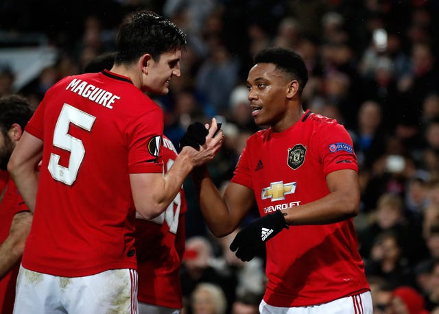 Anthony Martial celebrated with Harry Maguire after scoring his side's second goal