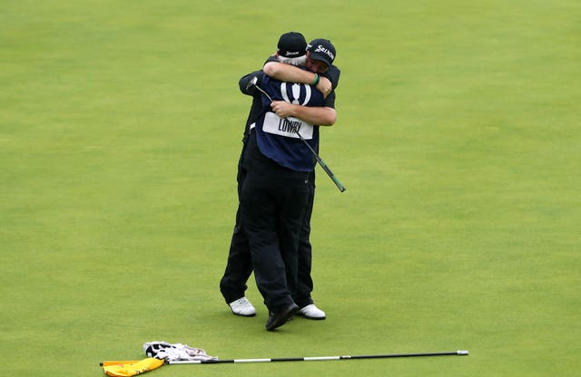 Shane Lowry celebrates winning the Claret Jug with caddie Bo Martin