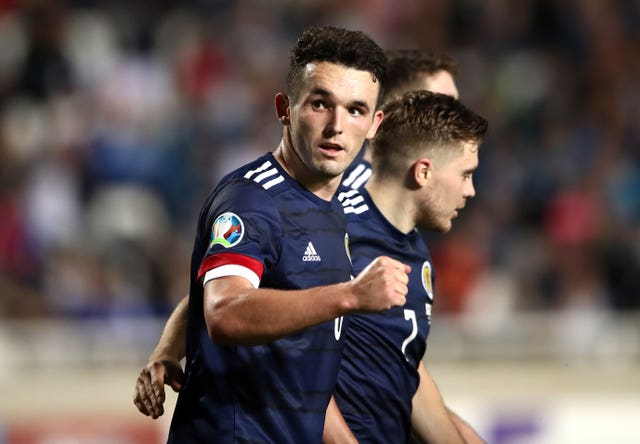 Scotland's John McGinn celebrates scoring the winner