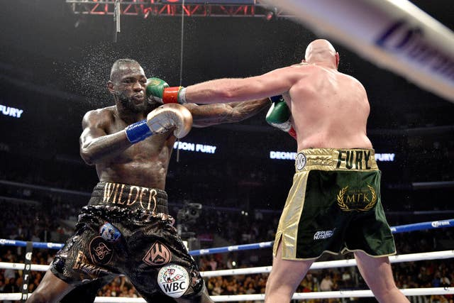 Wilder and Fury drew around 325,000 PPV buys for their first fight (Lionel Hahn/PA)