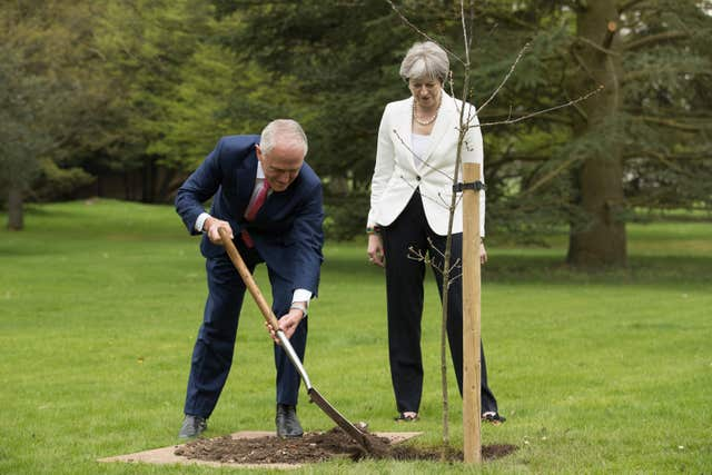 Mr Turnbull planted an English oak tree in the grounds (Aaron Chown/PA)