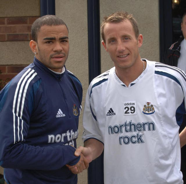 Kieron Dyer, left, and Lee Bowyer shake hands after their on-pitch brawl