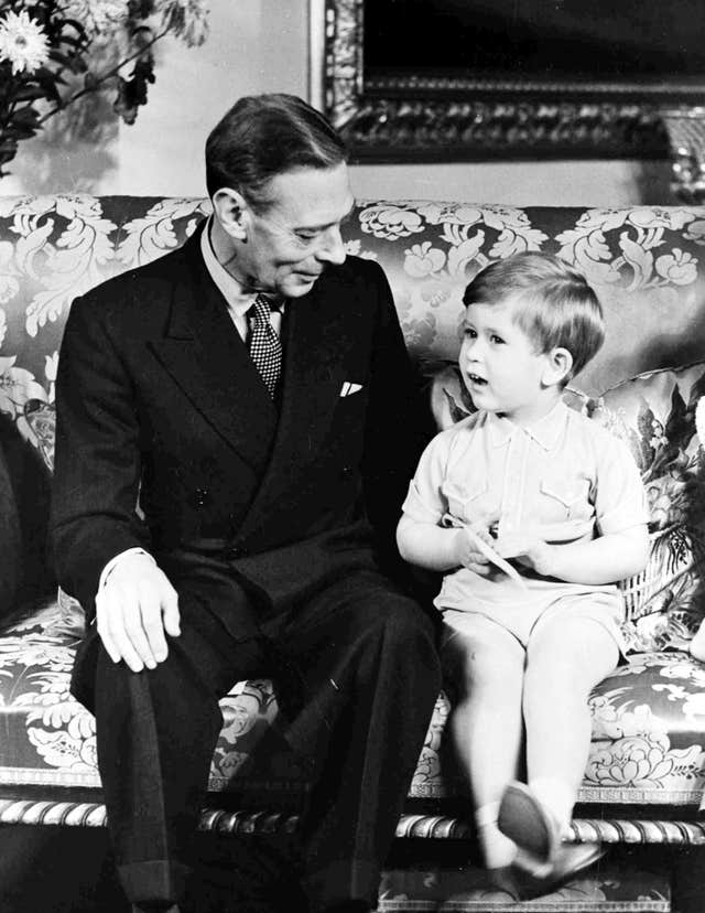 King George VI, pictured with Charles celebrating his third birthday at Buckingham Palace, features in the Queen's Christmas Day broadcast. PA/Wire