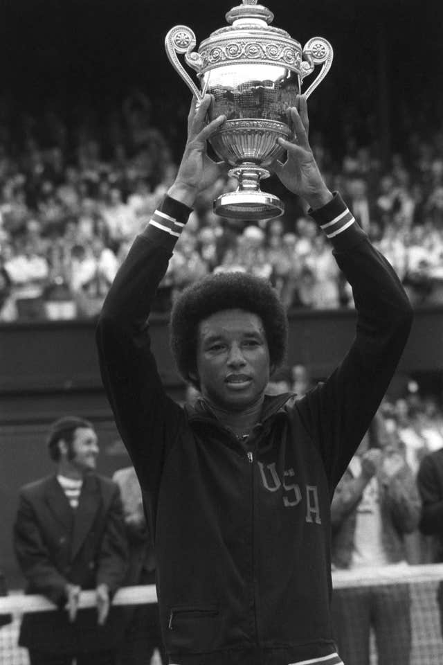 Arthur Ashe lifts the Wimbledon trophy in 1975