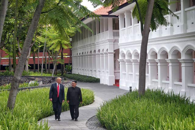 Donald Trump and Kim Jong Un during their first summit in Singapore (Kevin Lim/The Straits Times/PA)