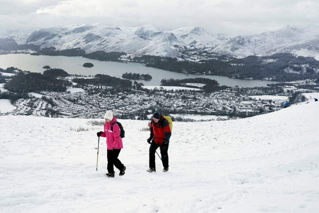 Hikers follow the Latrigg walk to take in the view of Lake Derwentwater (Owen Humphreys/PA)