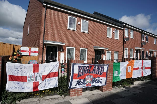 Flags outside houses in Ashington, Northumberland, ahead of Jack Charlton's funeral procession