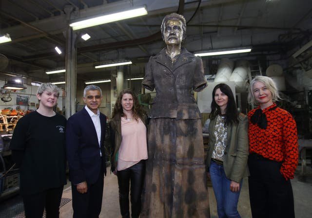 Technician Chloe Hughes (l to r), London Mayor Sadiq Khan, Caroline Criado-Perez, artist Gillian Wearing and Deputy Mayor for Culture and Creative Industries Justine Simons inspect the in-progress statue (Yui Mok/PA)