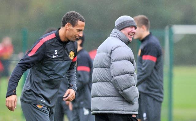 Rio Ferdinand, left, alongside his former boss at Manchester United Sir Alex Ferguson