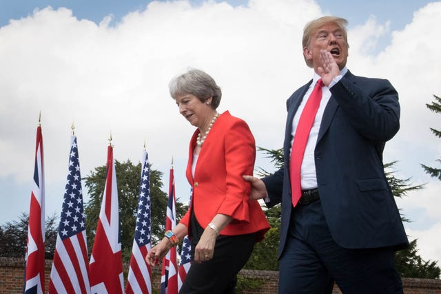 Donald Trump walks with Theresa May prior to a joint press conference at Chequers. (Stefan Rousseau/PA)