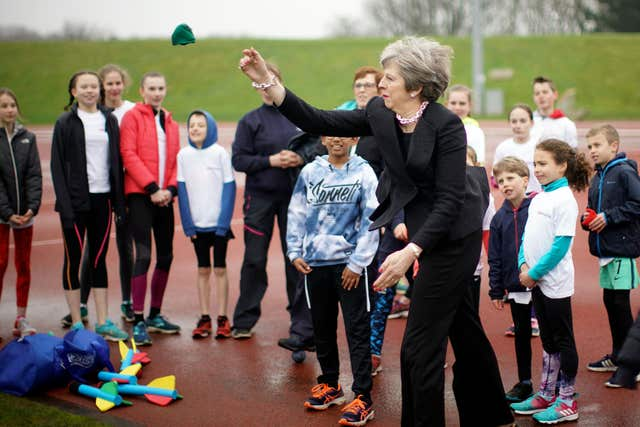 Prime Minister Theresa May throws a bean bag (Christopher Furlong/PA)