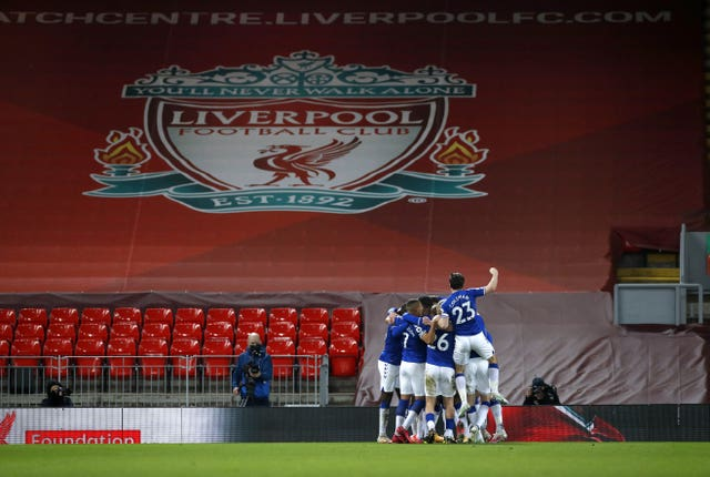 Everton players celebrate on their way to victory in the Merseyside derby
