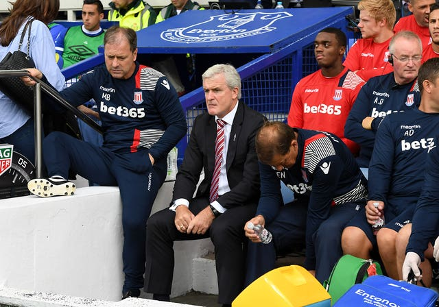 Mark Hughes, centre, shows his displeasure during Stoke's defeat at Everton last August