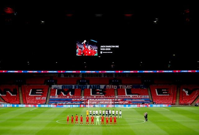 Players from England and Wales take part in a minute's applause in memory of footballers and fans who died this year ahead of an international friendly at Wembley in October. World Cup winners Norman Hunter, Jack Charlton, Nobby Stiles, Diego Maradona and Paolo Rossi are among the ex-footballers to have died during 2020. England won the match 3-0 thanks to goals from Dominic Calvert-Lewin, Conor Coady and Danny Ings