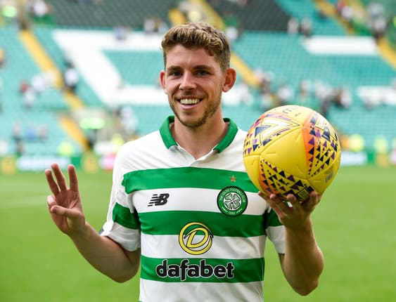 Ryan Christie celebrates with the match ball after his hat-trick