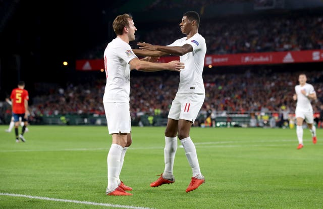 Marcus Rashford, right, could one day be on a par with Harry Kane, left, according to Ole Gunnar Solskjaer (Nick Potts/PA)